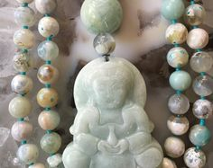 108 ruby zoisite 8mm beads, agate guru bead and a Kuan Yin aventurine carved focal bead.  Ruby in zoisite is perfect for mending broken hearts and helping to calm obsessive feelings towards another person. Ruby zoisite increases ones awareness of individuality, however still sustaining connections to all humanity. It can help bring lucidity to the dream state.  Typical lengths of the beaded portion of my 108 bead Malas: 6mm: 30 8mm: 39 10mm: 48  All of our Malas come with a lifetime free…