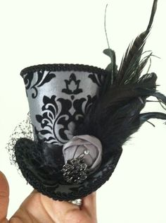 Damask- gray and black mini top hat with feathers and french veil netting. $45.00, via Etsy.