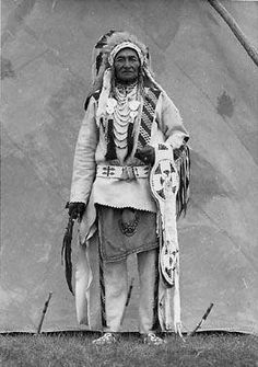 Joe Calf Child - Blackfoot - 1939 {Note the impressive beaded blanket strip, not mounted on a blanket.}