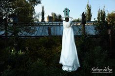 My favorite ever dress image that I have photographed. The day before the wedding I walked around the grounds and saw the birdhouses and I knew that would be the perfect spot for the dress. This image was taken just as the sun had risen. My sister is holding an off camera flash directed on to the dress. A perfect image.    Wedding dresses, McMenamins Edgefield Wedding Photography, Kathryn LeBoye Photography