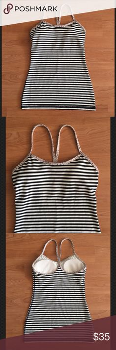 Lululemon striped power Y tank leopard print trim Great lululemon power Y tank! Black and white stripes with leopard print trim. Lightly padded bra insets. Tag size 4. In great condition! Thank you. lululemon athletica Tops Tank Tops
