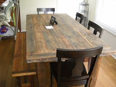 reclaimed wood dining table!!! love love love...stained a dark walnut perhaps, yes.