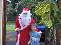 Grandson with neighbour dress as Father Christmas. 2004
