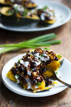 Mexican Roasted Corn and Quinoa Stuffed Squash: Loaded with red quinoa, black beans, roasted corn, and cheddar cheese. High protein, high fiber, and just 200 calories. #Acorn_Squash #Quinoa #Black_Beans #Corn #Cheddar #Healthy