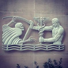 Man holding back Death with medicine (using the incorrect symbol, but whatev) on the Public Health building in Atlanta