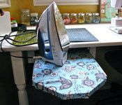 Hiding your ironing board has never been easier! Watch this video and learn how to make a slide-out ironing board that you can stow under your sewing table or desk. Sewing Spaces, My Sewing Room, Small Sewing Space, Ikea Sewing Rooms, Sewing Room Organization, Craft Room Storage, Organization Ideas, Ironing Board Covers, Ironing Boards