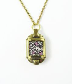 """Upcycled rolled gold wristwatch case pendant: Liberty of London Grayson Perry """"Cranford"""" baby pink print fabric by ohyouhandsomedevil on Etsy"""