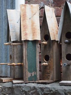 Rustic birdhouses constructed by vintage timber gates and aged wooden fence palings. Roofed with rusting corrugated iron, by Boodle Concepts.