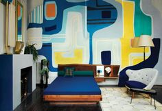 The master bedroom has a bold graphic wall that looks as an oversized art piece