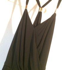Black jumpsuit NWT Gold hardware chic black jumpsuit. Stretch material, super sexy. Jennifer Lopez Other