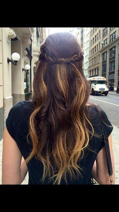Half up half down wavy hair with plait.