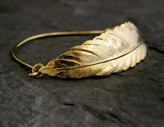 Check out this item in my Etsy shop https://www.etsy.com/listing/86723661/gold-feather-bracelet-bridal-accessories