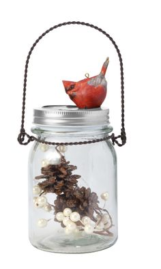Bring a little nature to your jar decorating with pine cones and cardinal ornaments.