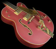 Gretsch Custom Shop '59 Falcon Heavy Relic. I was never big on Gretsch, but this one is sexy.