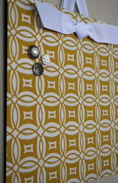 "Fabric Magnet Board (12"" x 12"") Rings in Mustard. $21.50, via Etsy."