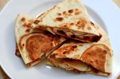 Kid-friendly chicken apple quesadilla recipe, toasted flour tortillas with melted cheese, apple slices, chicken, and salsa.