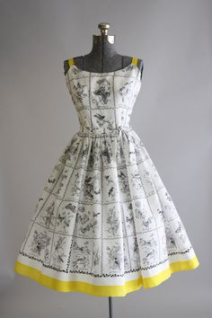This 1950s cotton Jerry Gilden dress features a black nature novelty print with birds, butterflies and flowers. Yellow straps and yellow trim