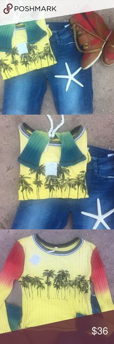 """Free People """"Me & All My Friends""""Crop Top  NWT Super cute island theme, red gold and green Rastafarian-nod SOFT top from FP. I just adore the saying """"me and all my friends"""" underneath the palm trees. Trees are our friends. This top is an extra large but I am 110lbs a size 2 with 34C and it fits me comfortably. It is short but not a crop top length. This is brand new with tags from our smoke-free pet free environment. No trades please submit all offers using the button. #PoshCompliant Free…"""