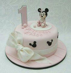 Minnie Mouse is so adorable with her long eyelashes and cute crown on this cake by Emma Jayne Cake Design Baby Minnie Mouse Cake, Mini Mouse Birthday Cake, Minnie Mouse First Birthday, Special Birthday Cakes, Love Cake Topper, Baby Girl Cakes, Cake Shapes, Cupcake Party, Fondant Cakes