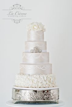 Five tier wedding cake with white sugar roses, pearlized fondant, and sparkling brooches