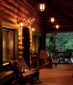Love the lights around the door of this cabin porch ~ Arts & Crafts lanterns, Rejuvenation #countryliving and #dreamporch