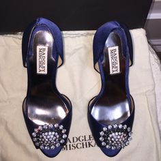 "FIRM/Badgley Mischka Navy Satin peep toe heels Badgley Mischka Navy Satin peep toe with elegant crystals.  Light up the night at a Black Tie Affair.  Shoes has extra heel caps, dust bag, extra Crystal, leather Sole and in original box.  Heel height: 2.5"" Badgley Mischka Shoes Heels"