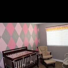 Pink yellow and gray nursery- the hubby did the painting. Amazing.