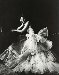 *    Photographed by Milton Greene, 1953