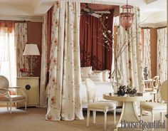 In this romantic master bedroom, designer Barry Dixon used floral bed hangings and window panels from Sanderson.