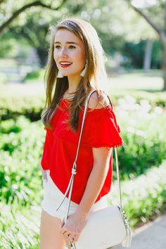 red off the shoulder top, white tassel earrings, white kate spade crossbody tassel bag