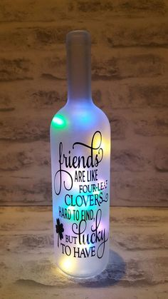 A recycled Wine bottle (Clear) which has been frosted a. CricutA recycled Wine bottle (Clear) which has been frosted and converted into a lamp by inserting LED Cork lights, powered by 3 Batteries, this bottle lamp will make a beaut Wine Bottle Gift, Glass Bottle Crafts, Diy Bottle, Bottle Art, Beer Bottle, Painted Wine Bottles, Lighted Wine Bottles, Bottle Lights, Bottles And Jars