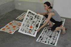 Artist Isabella Trimmel, in her studio, working on a new series of  original abstract paintings in black, grey and orange tones. Find more at www.art-y-sana.com