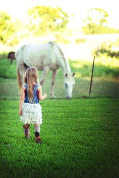 My beautiful daughter Presley at 5 years old in 2015 walking towards her horse Stellar that she received as her 1st birthday present in 2011 when he was only 3 months old.  Stellar is an appaloosa quarter horse cross.  Photography by:  Theresa R.S. Thurman - redaquadreams