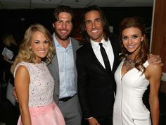 Carrie Underwood, Mike Fischer, Jake Owen, and Lacey Buchanan pause for a photo backstage at the 8th Annual ACM Honors at the Ryman Auditorium on September 9, 2014 in Nashville, Tennessee.