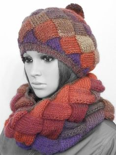 This hand knitted set of beanie (beret), cowl and fingerless mittens is made of a high quality wool yarn. Soft and warm set to brighten up the
