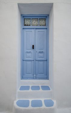 a simpe blue door in the town of Chora in Serifos, Greece by Claire Kelly on 500px