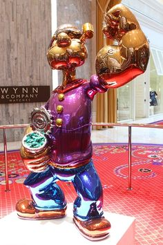 Popeye   Popeye Sculpture  Also under close watch (two guards on this one) is a statue of Popeye which Steve Wynn purchased for (drum roll) nearly $28.2 million. Dollars.  The statue was created by artist Jeff Koons.    Popeye statue at Wynn Las Vegas.