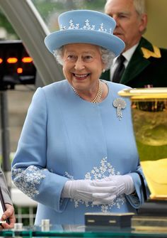 The Queen hosts champagne parties for her staff to toast the royal birth.