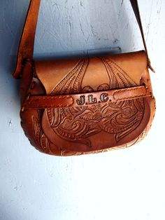 VTG Leather Tooled Satchel Floral Tooled 60's Purse. $75.00, via Etsy.