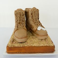 This is very impressive because the shape of a boot is hard to make and the attention to detail down to the laces is amazing. The dog tags are nicely done as well. I'm thinking the dirt may be graham cracker crumbs?