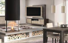 Ambiente con pocos muebles y con panel giratorio para la televisión
