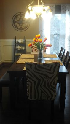 An updated dining room - Walls, lighting, printed chairs, dark wood furniture