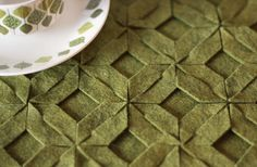 here's a template for making a larger modular felt trivet. No sewing or gluing required. Connect as many pieces as you like to make bigger projects, too--placemats, a runner, or sew two pieces together for a pillow cover.
