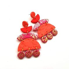 Magenta pink and coral. Dangle earrings in vibrant colours. Magenta pink and coral. Dangle earrings in vibrant colours. Shop link in bio Etsy Earrings, Dangle Earrings, Handmade Jewellery Uk, Magenta, Coral, Surgical Steel Earrings, Etsy Uk, Handmade Polymer Clay, Polymer Clay Earrings