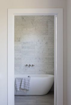 Pretty tub, like the faucet on the wall. Between the windows for placement?