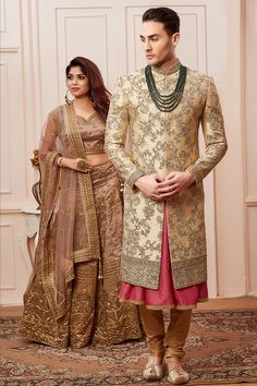Cream color multicolor flower designer wedding sherwani.