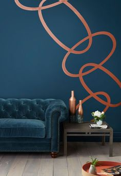 Dark blue is a classic 'cocooning' colour, and looks great in any season, depending on what you put with it. These walls are painted in Resene Tangaroa, a rich marine blue, with swirls in Resene Copper Fire. The floor is finished in Resene Colorwood Greywash. Photo by Bryce Carleton.