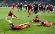 Gareth Bale leads the rest of the Wales squad as they slide on their fronts in front of the travelling supporters as they celebrate Football Ads, Uefa Euro 2016, Gareth Bale, Bosnia, Manchester United, Wales, Athlete, Seal, Soccer
