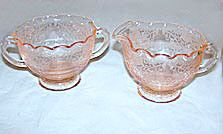 This is a Depression Glass pink cream and sugar set in the Florentine 1 pattern made by Hazel Atlas. It is the hard to find ruffled top set and they are in very nice condition with no chips or cracks.