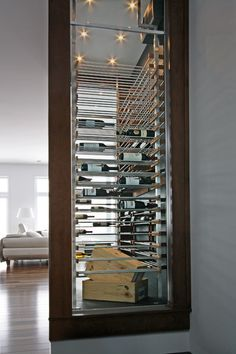 We built the Millesime wine racks with premium woods such as mahogany and walnut. The fusion of the traditional wood with the refined look of the glass makes a wonderful and unique wine cellar. Glass Wine Cellar, Home Wine Cellars, Wine Cellar Design, Contemporary Wine Racks, Wine Wall, Wine Fridge, Wine Storage, Bars For Home, House Design